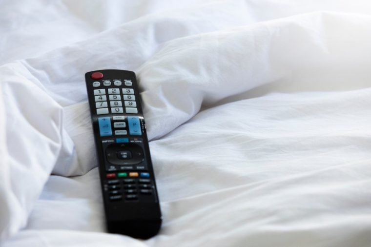 Remote control,Remote control on the bed,Remote control and blanket