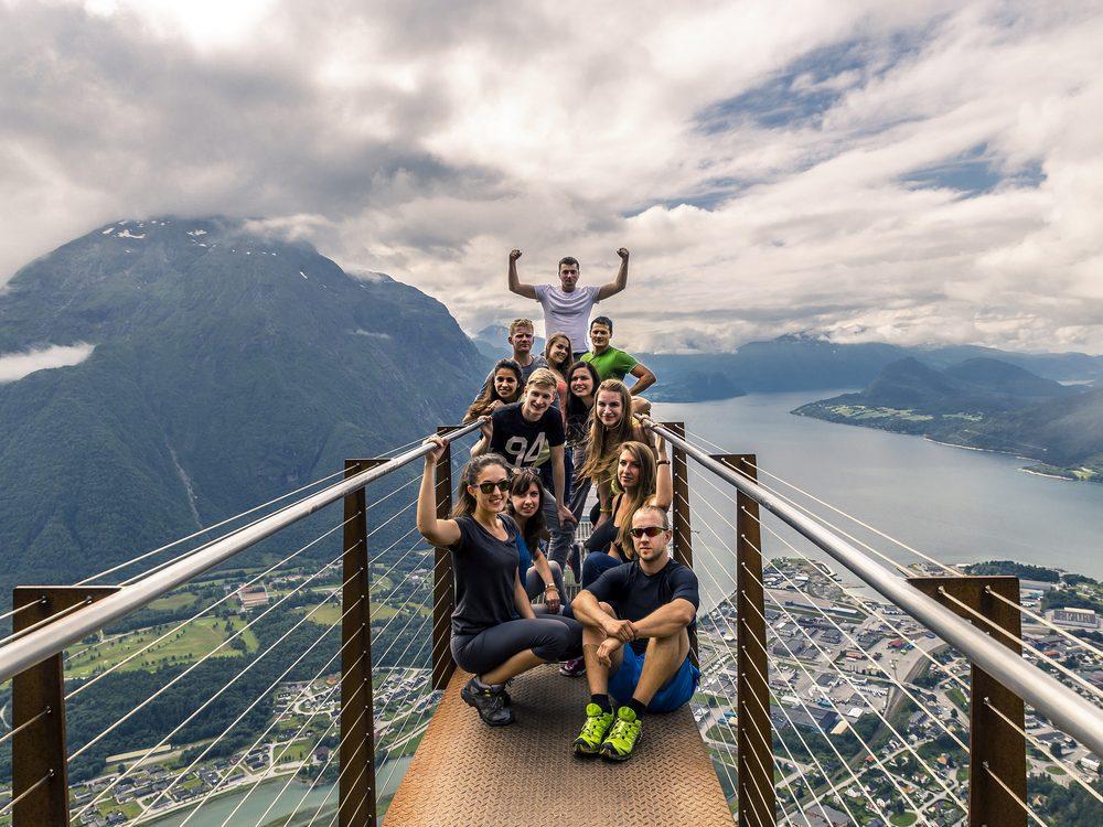Friends posing on mountain