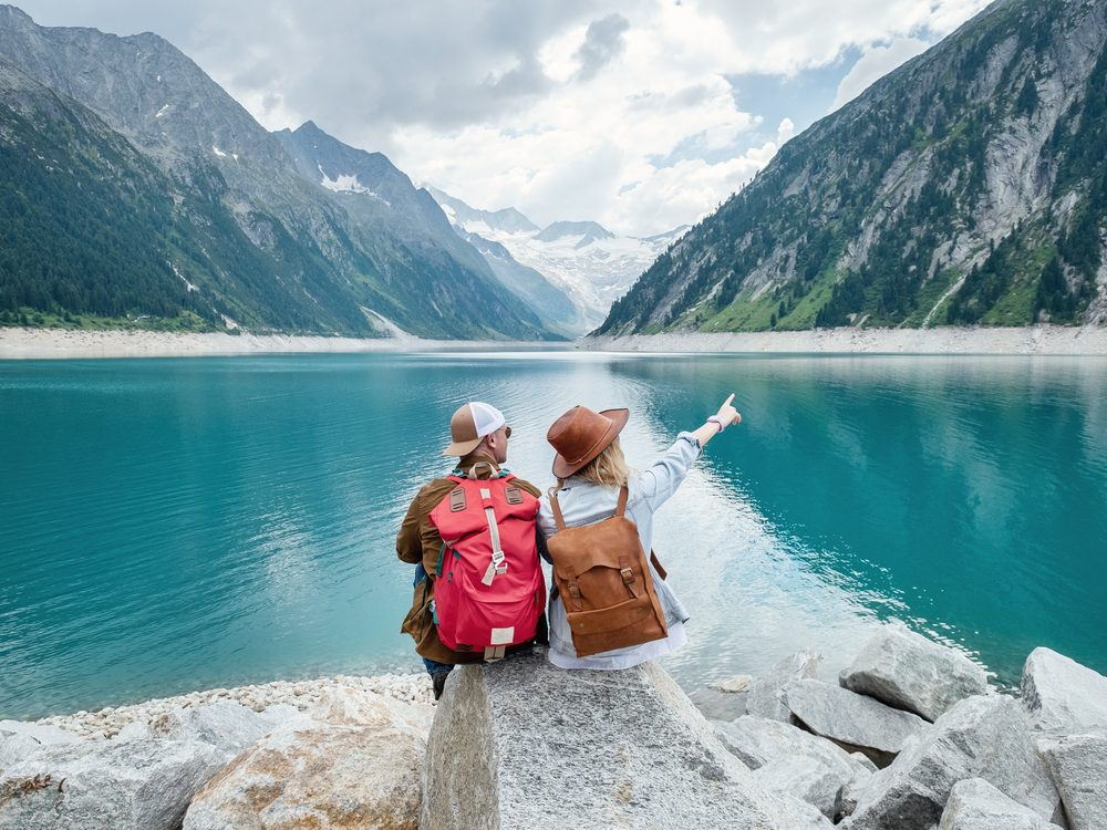 Two friends in awe of mountainous landscape