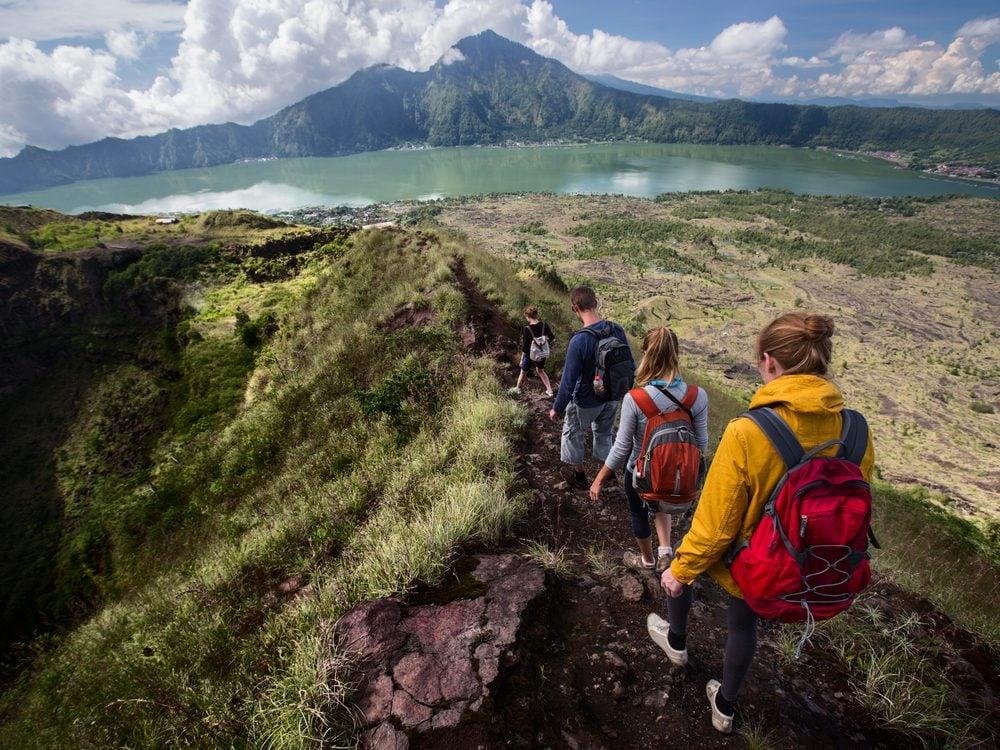 Hikers walking down a mountain trail