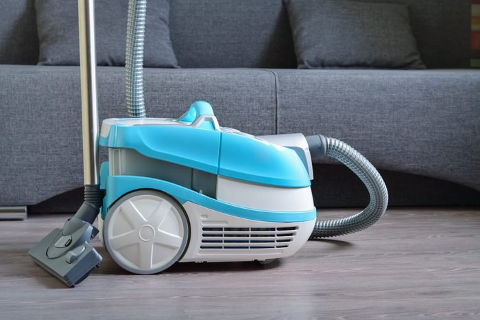 Multifunctional vacuum cleaner on the laminate floor.