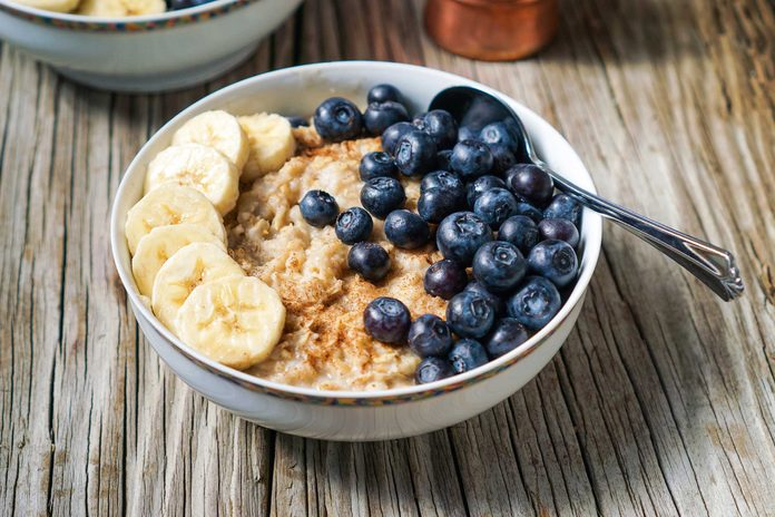 bowl of oats with bananas and blueberries