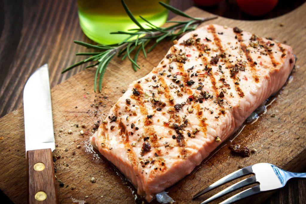 salmon steak on cutting board