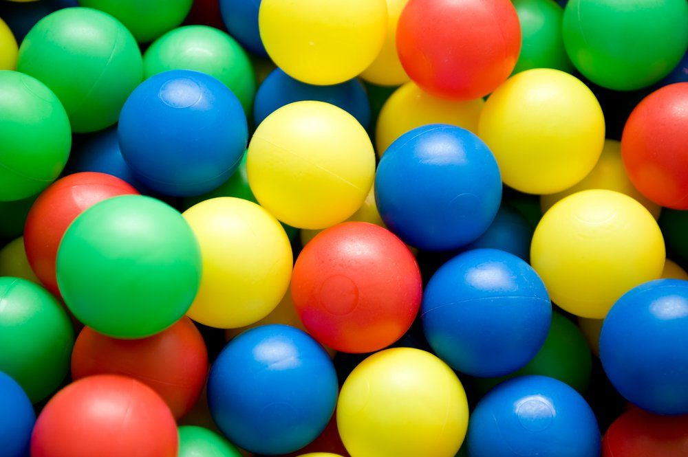 object on white - color balls close up