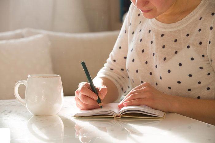 woman writing notes