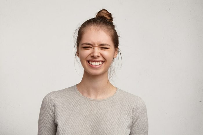Smiling woman with eyes closed
