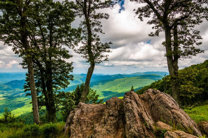 Boulders, trees, and view of the Blue Ridge at an overlook on Skyline Drive in Shenandoah National Park, Virginia.