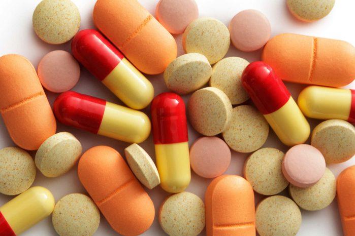 yellow, orange, and red pills