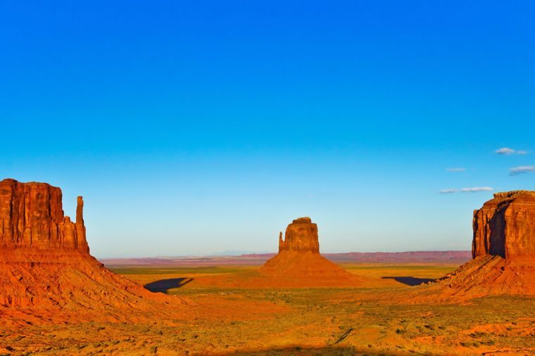 View of Monument Valley at sunset near the border of Arizona and Utah in Navajo Nation Reservation in USA.