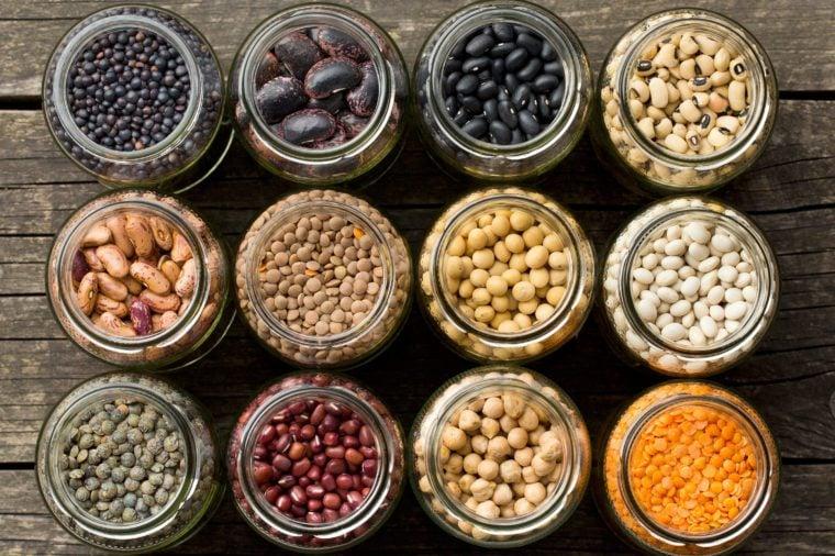 top view of various dried legumes in jars