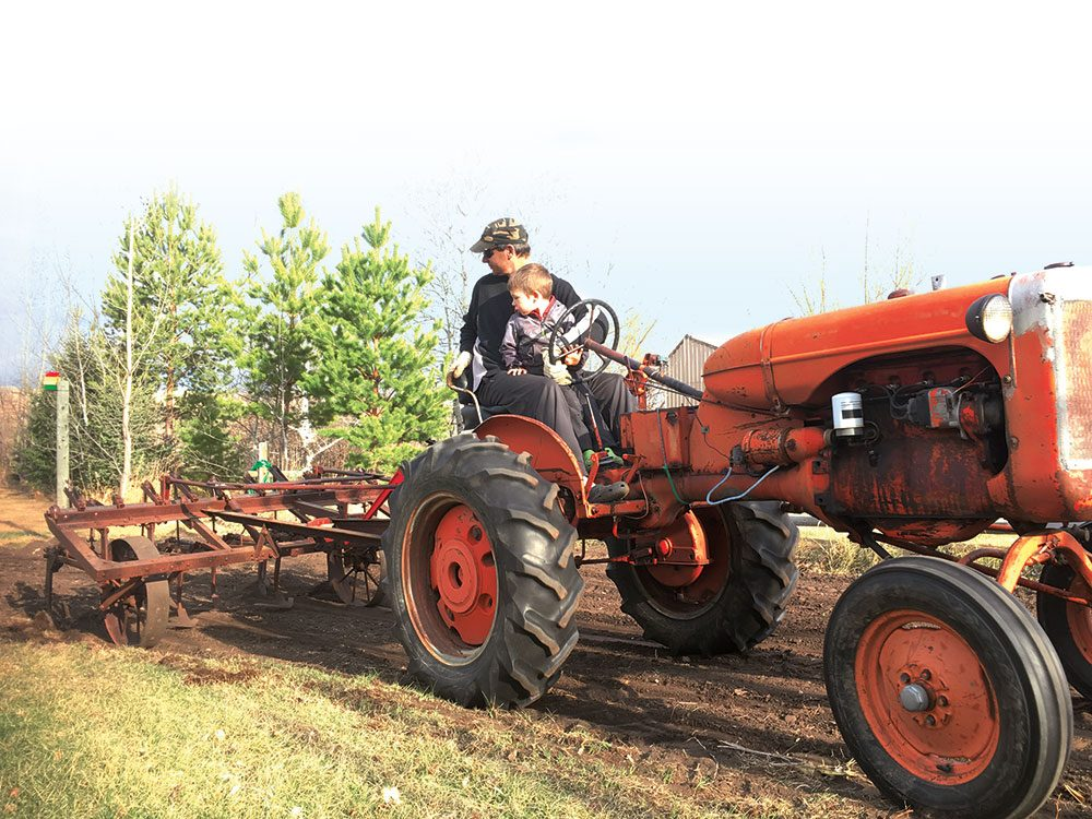 For the love of farming - father and son on tractor