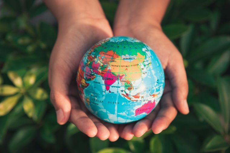 Save the earth concept, Woman hands is holding mockup the global on tree leave background.