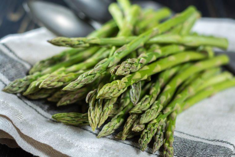 Fresh white and green asparagus on linen napkin