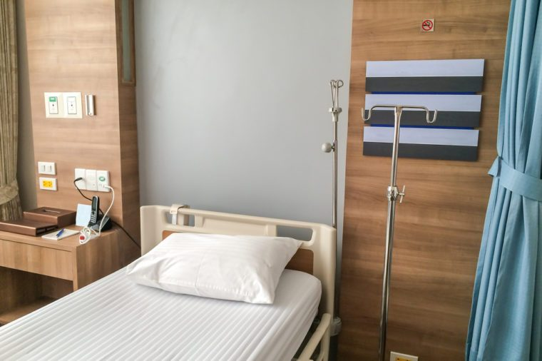 Empty hospital bed with medical equipment