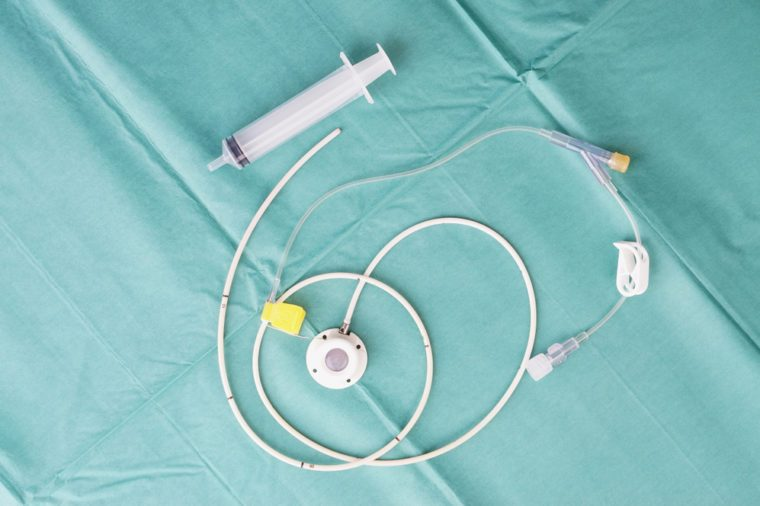 Port for a catheter or central venous port insertion, puncture at chest wall to aorta artery a medical device as silicone cartridges, has flexible tube with needle and syringe