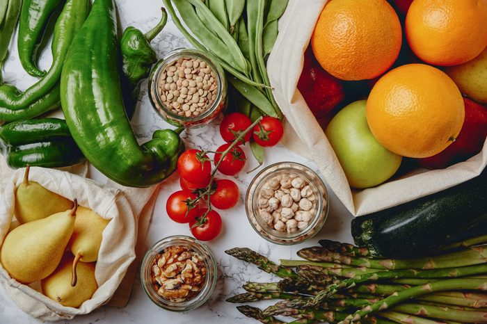Zero waste grocery shopping. Package-free food on marble background. Flat lay