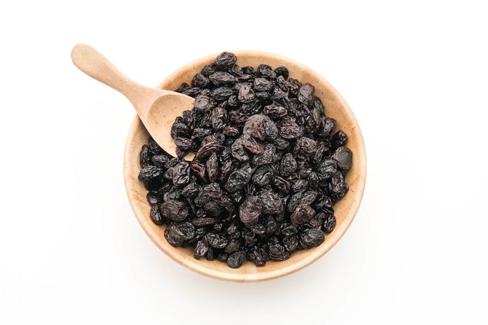 black raisins on white background