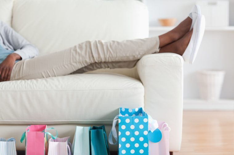 Young woman putting her feet up
