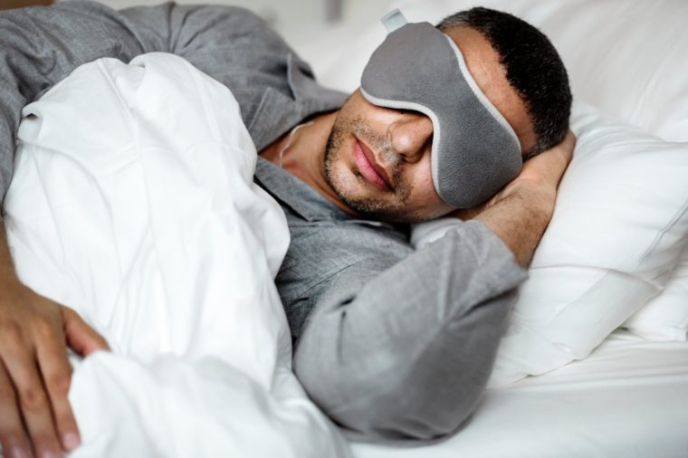 man sleeping bed eye sleep mask
