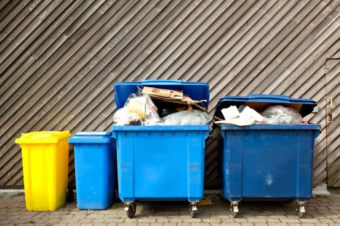 blue and yellow trash cans dumpsters