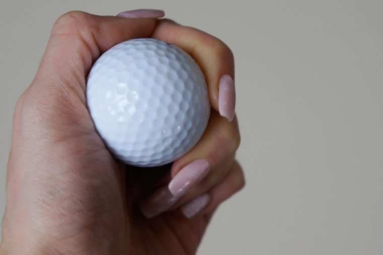 golf ball in hand