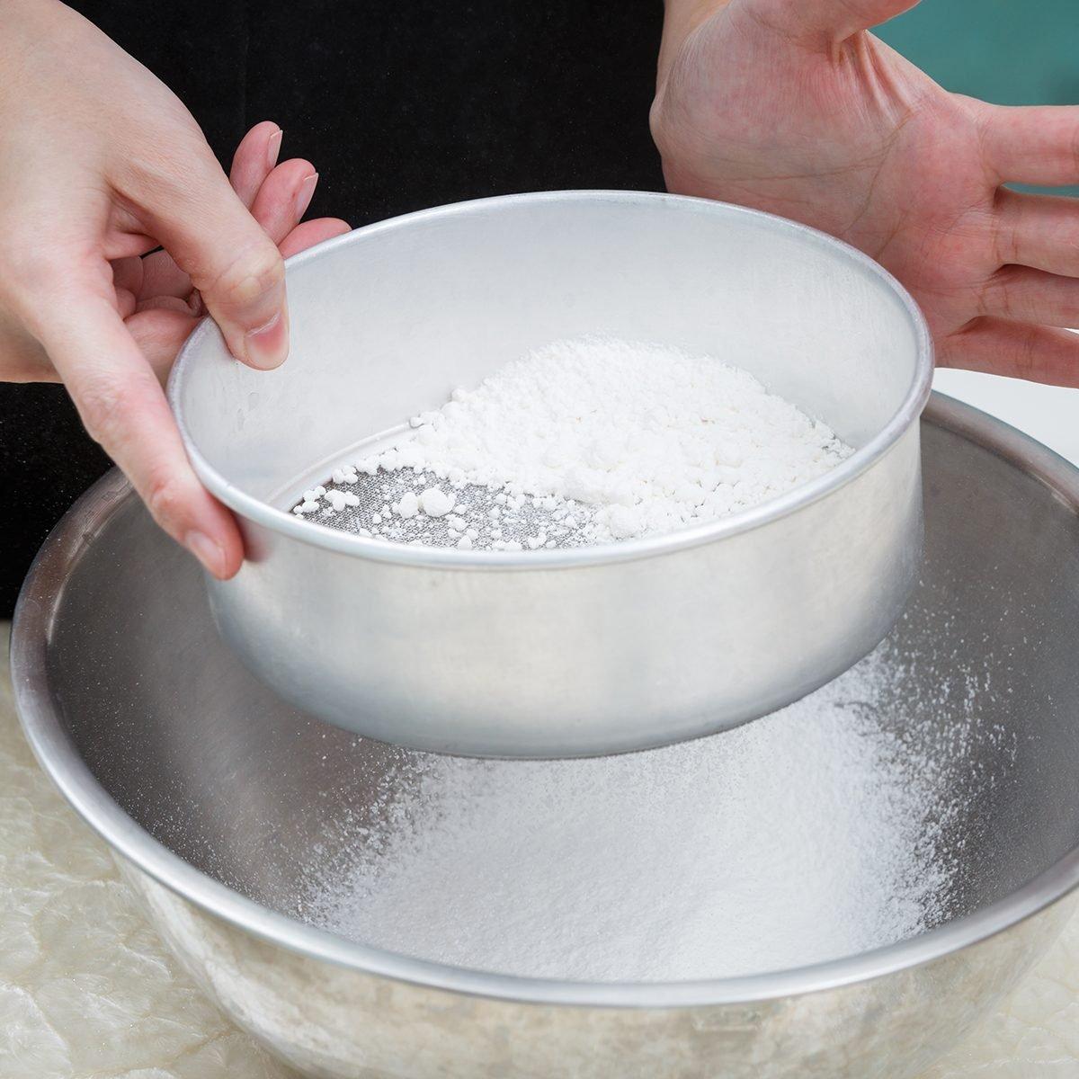 sifting flour with flour filter; Shutterstock ID 214900843; Job (TFH, TOH, RD, BNB, CWM, CM): TOH