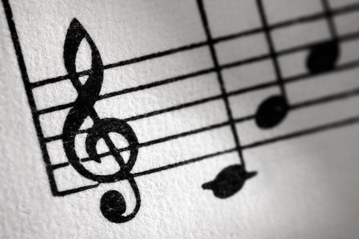 Treble clef and music sheet, diagonal image formation.