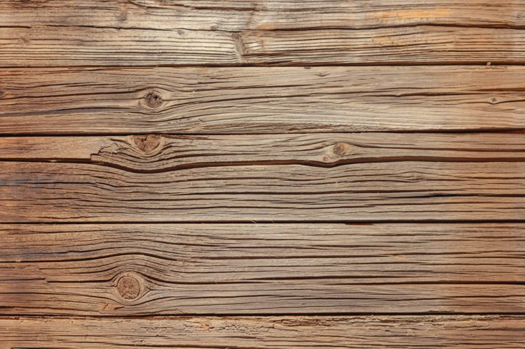 Full frame of old splintered brown wood background with copy space