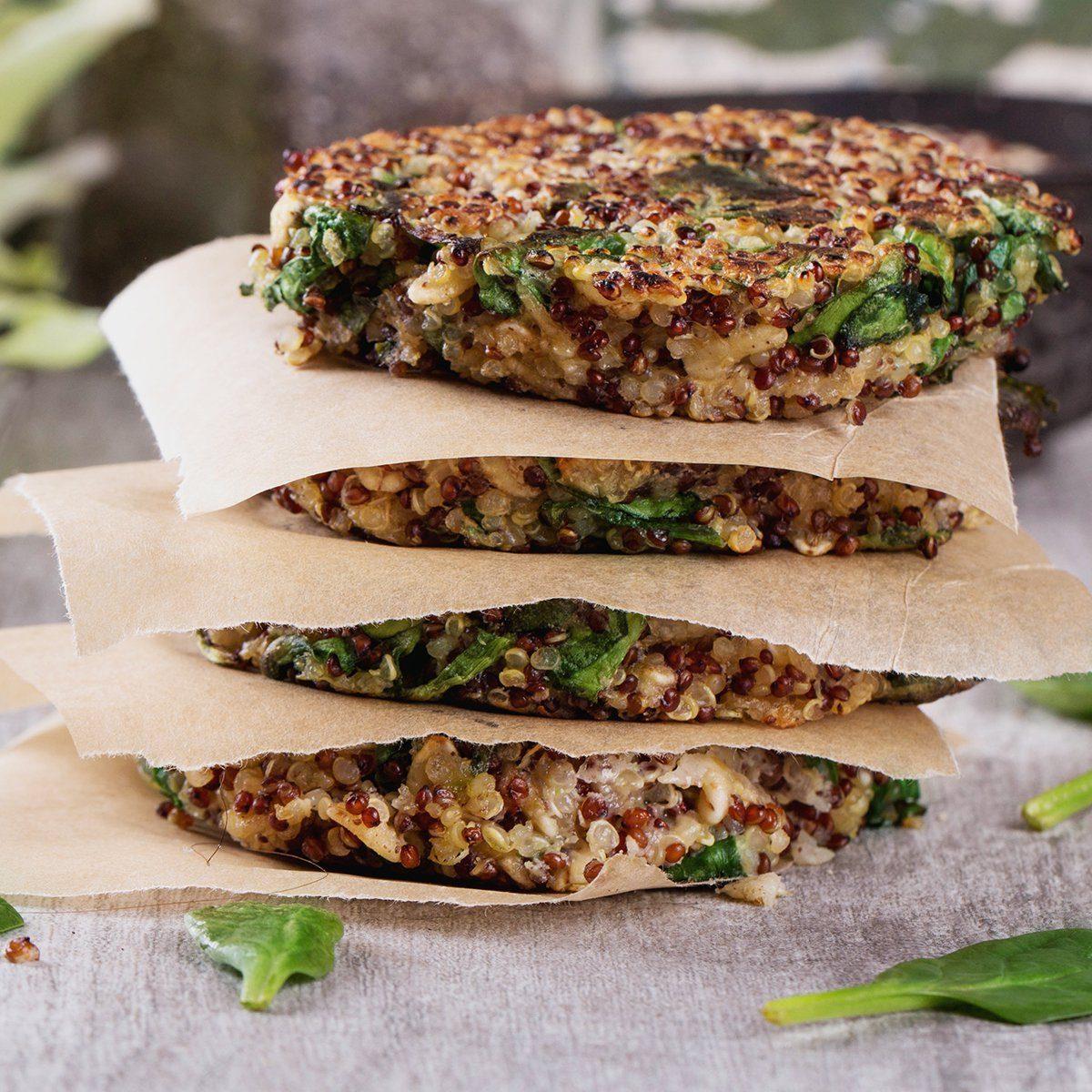 Veggie quinoa burgers with lettuce, tomato and spinach