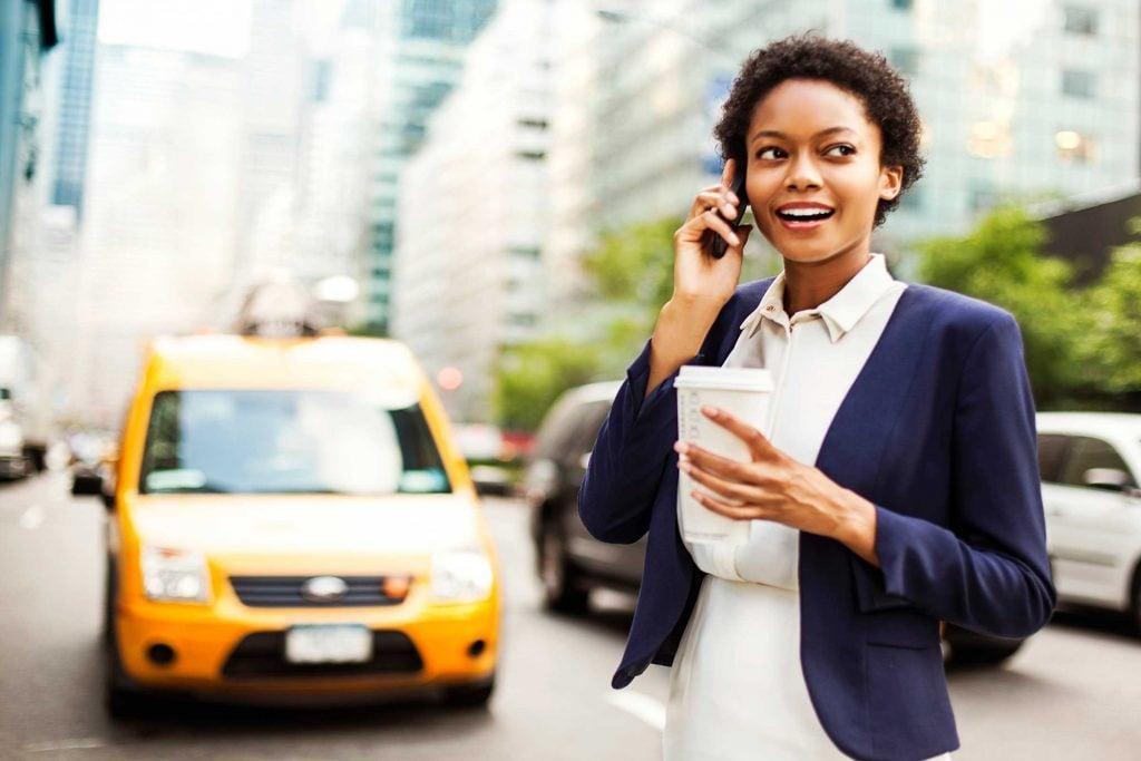 Businesswoman drinking coffee on the street