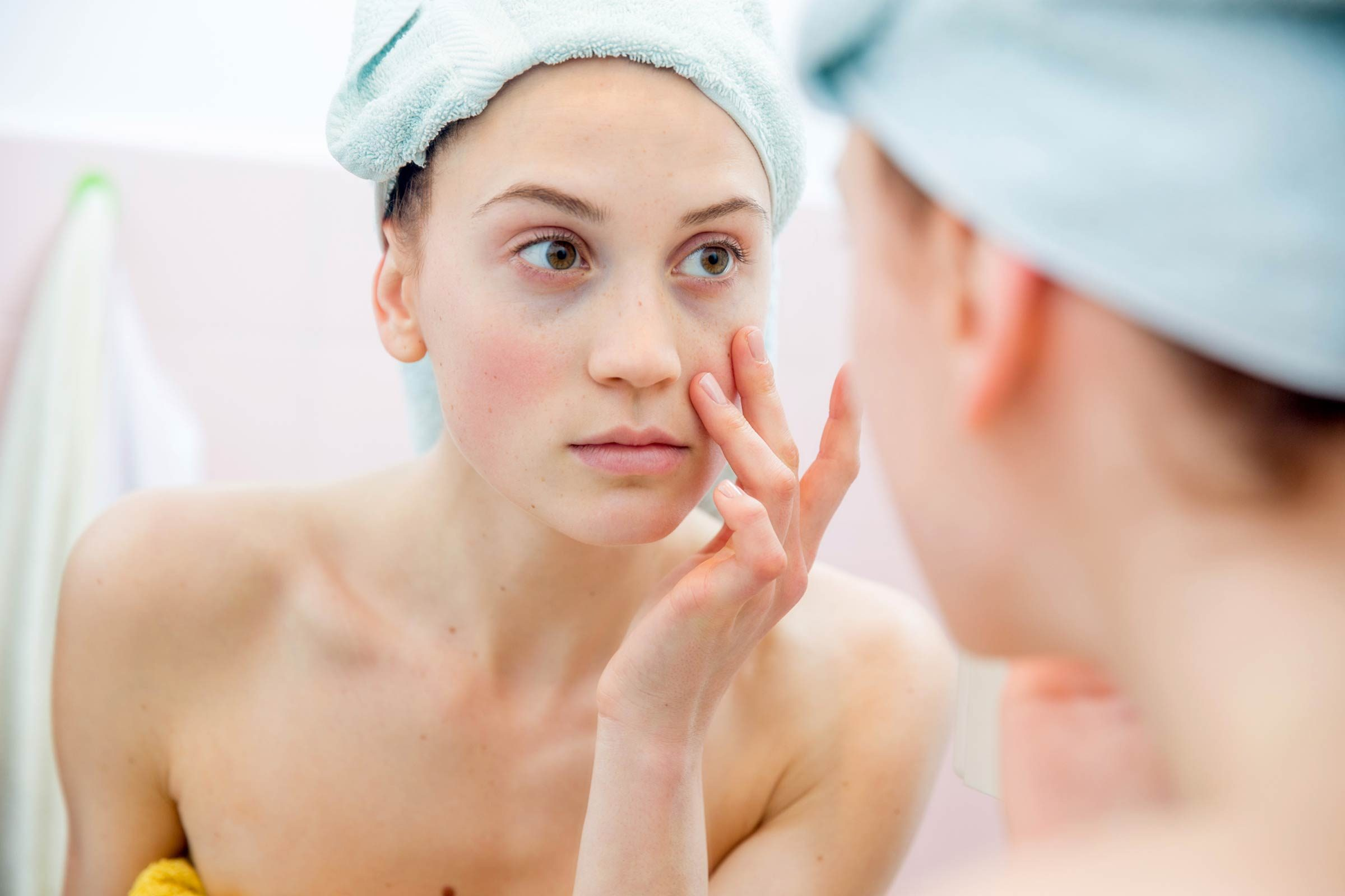 Woman going through her skin-care routine