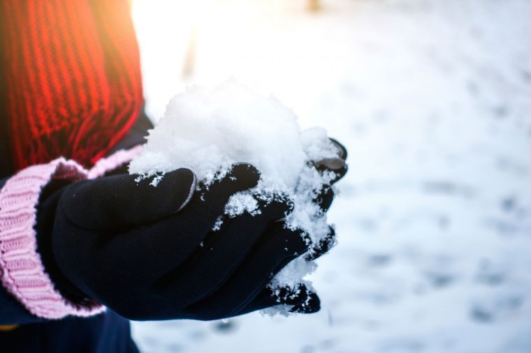 Holding snow in gloves