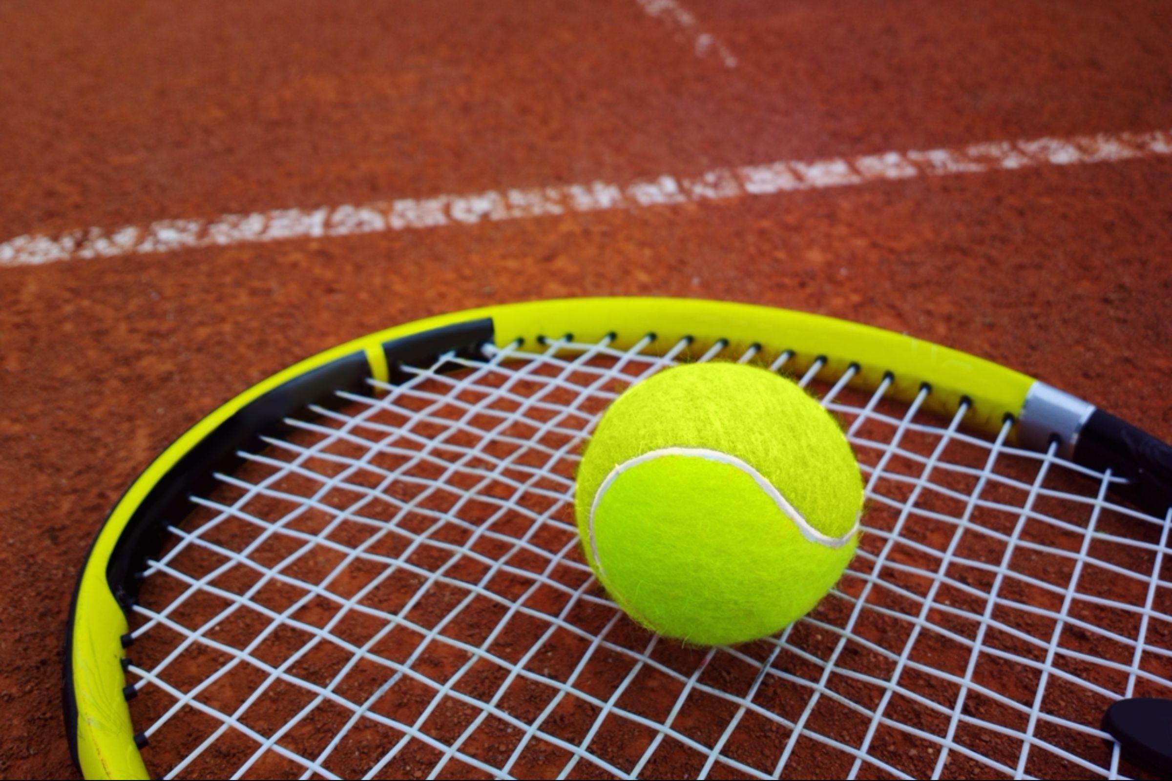 Tennis ball on tennis racket