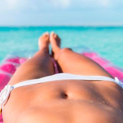 Woman sunbathing on a raft