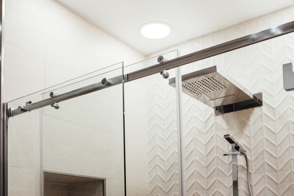 Metal structure of the upper fasteners and rollers for the sliding glass door in the shower view in white the interior
