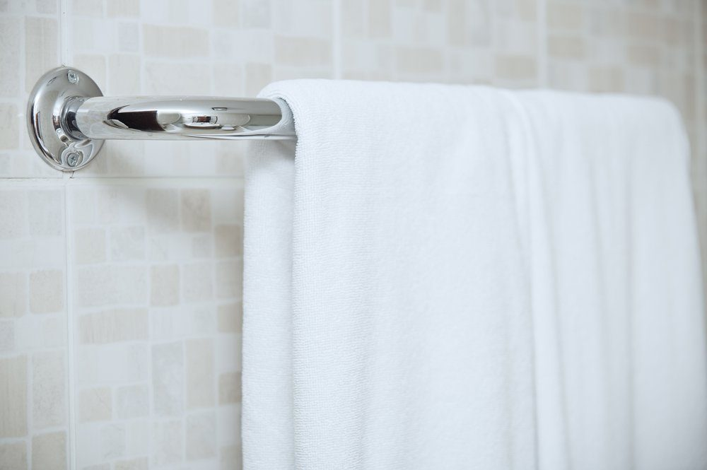 Towel drying on the rail in bathroom