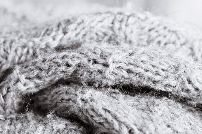 Grey wool knitwear as a detailed abstract