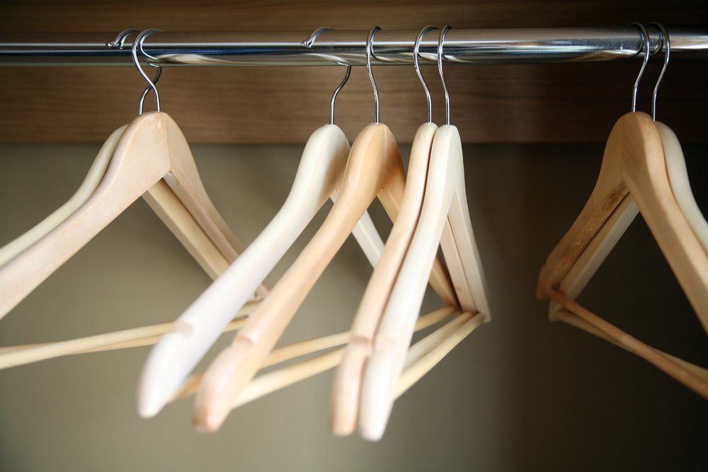 empty hangers for clothes on rail, after sale
