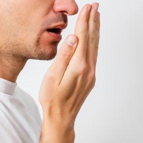 Body Odour - Man Smelling Breath