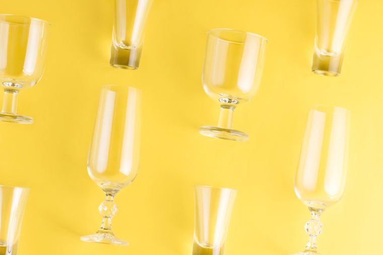 Collection of various glasses on bright background, copy space