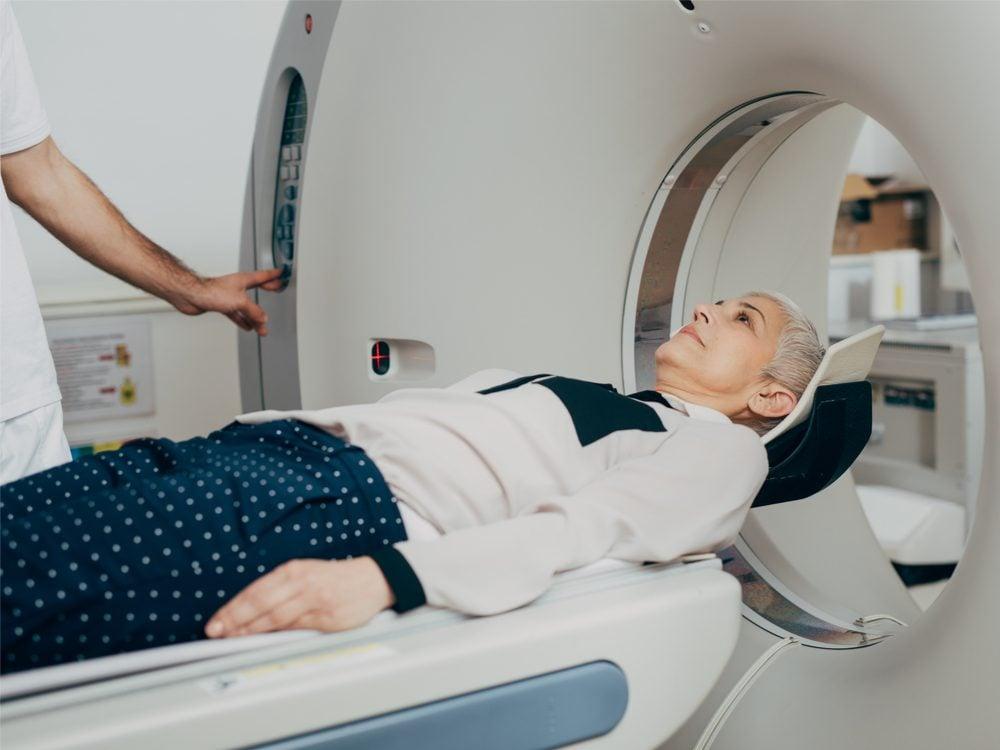 Woman entering CT scanner
