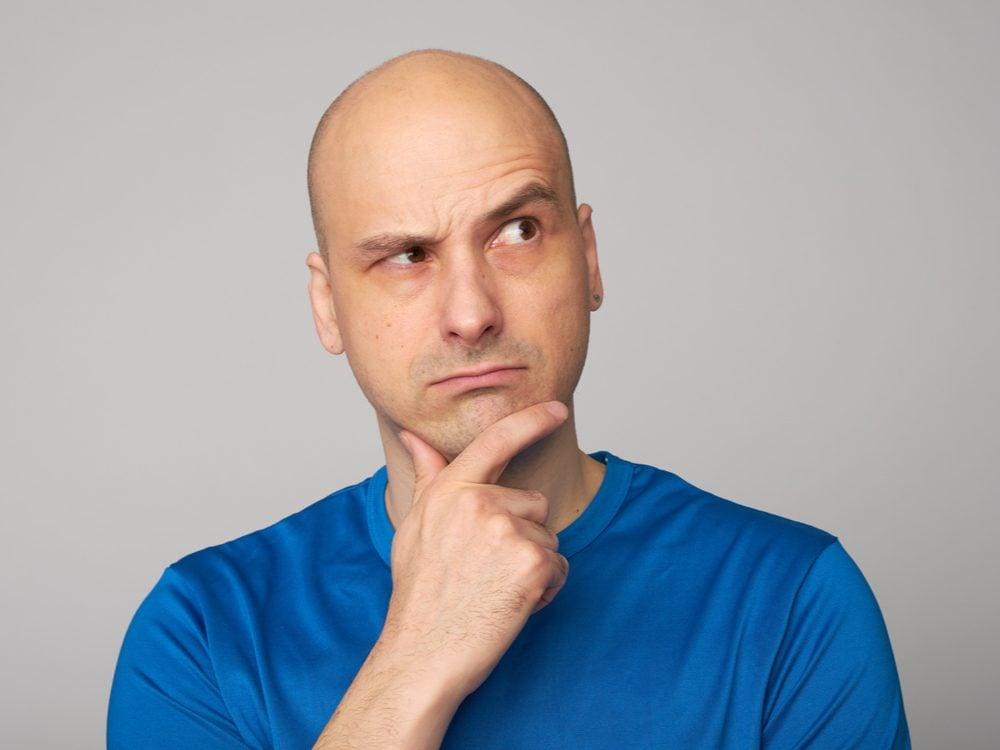 Bald man raising eyebrow
