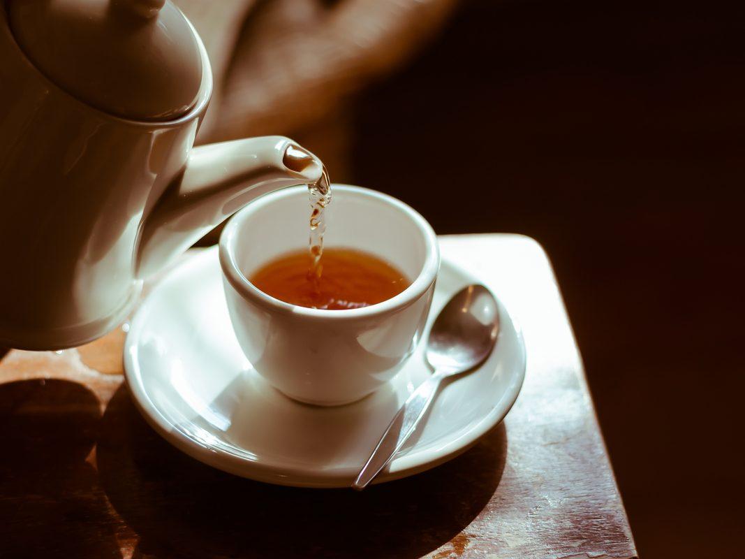 Pour tea into white cup