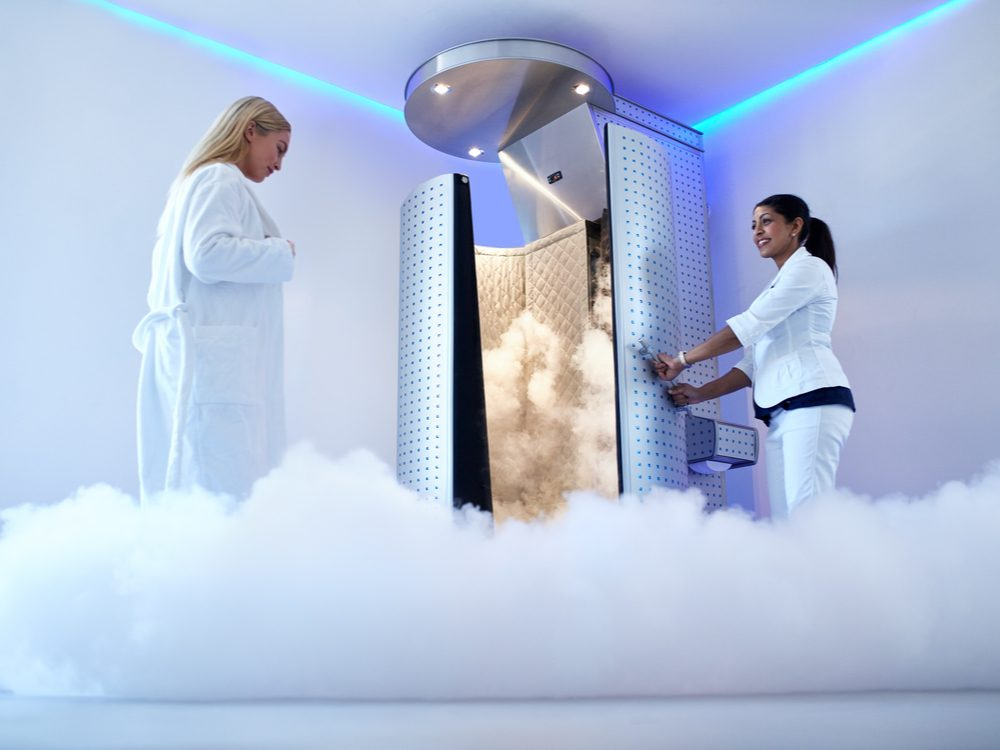 Woman entering cryotherapy booth