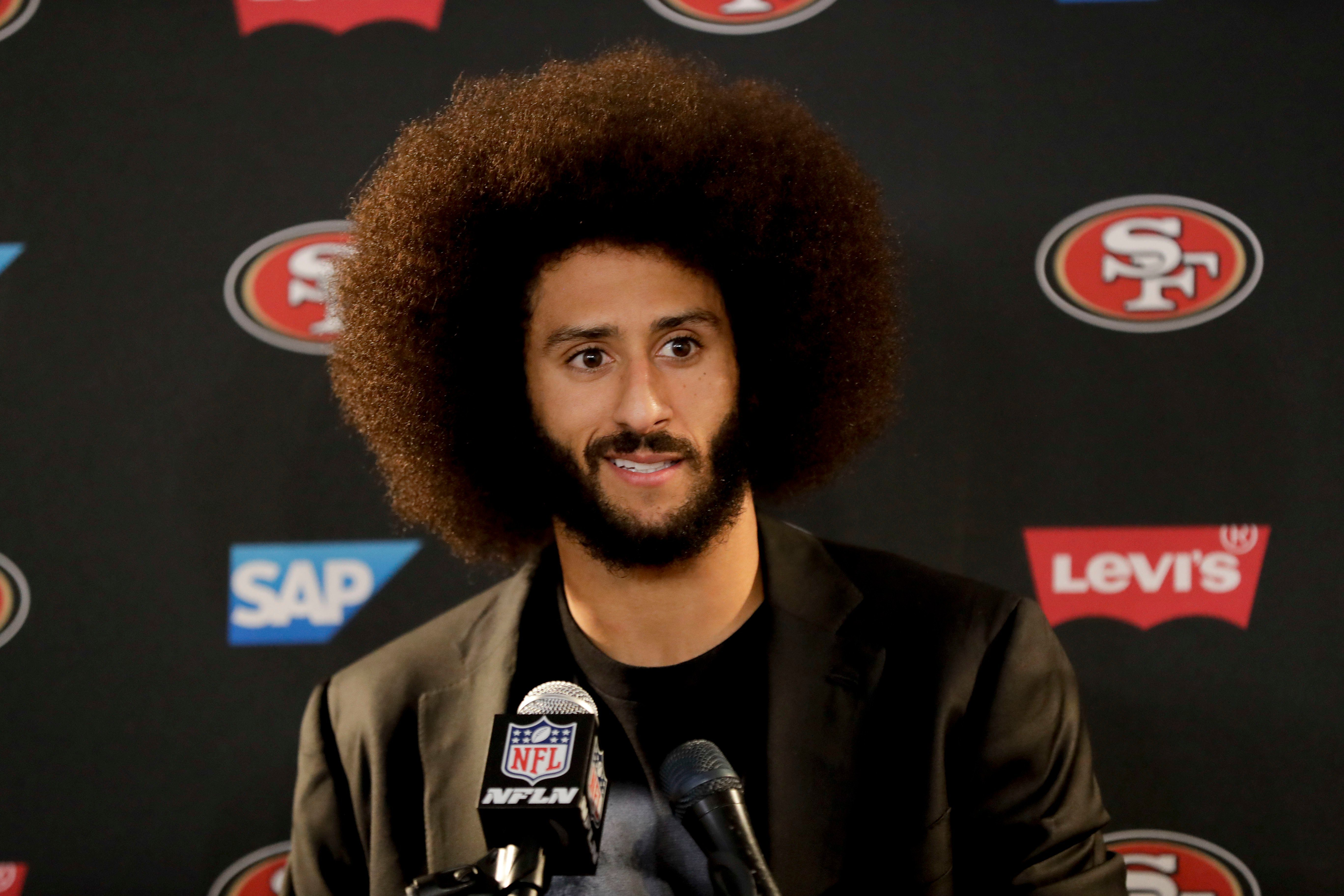 Mandatory Credit: Photo by AP/Shutterstock (9137518a) This Dec. 24, 2016 photo shows San Francisco 49ers quarterback Colin Kaepernick talking during a news conference after an NFL football game against the Los Angeles Rams. Kaepernick filed a grievance against the NFL on alleging that he remains unsigned as a result of collusion by owners following his protests during the national anthem Kaepernick-Grievance Football, Los Angeles, USA - 25 Dec 2016