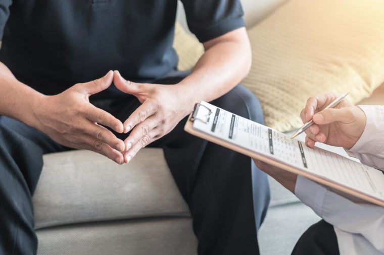 Male patient having consultation with doctor or psychiatrist