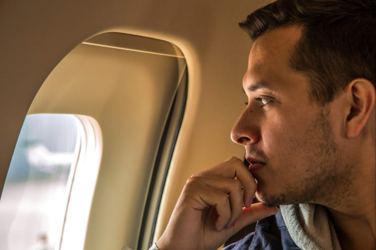 Man looking out of airplane window