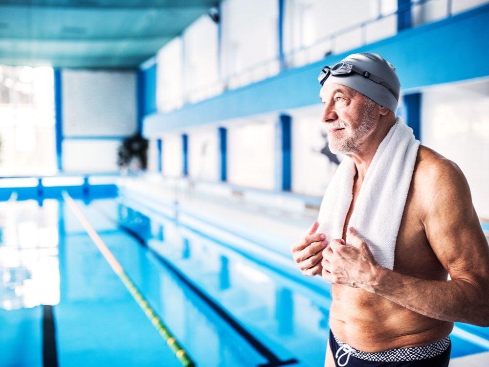 Man beside pool in swim suit