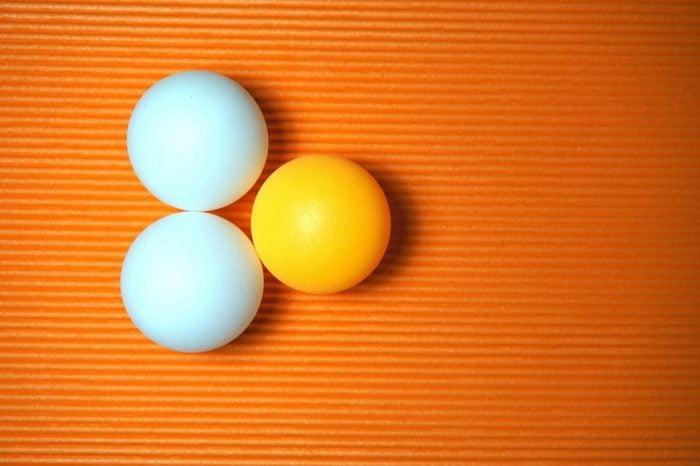 Ping Pong balls on the orange background