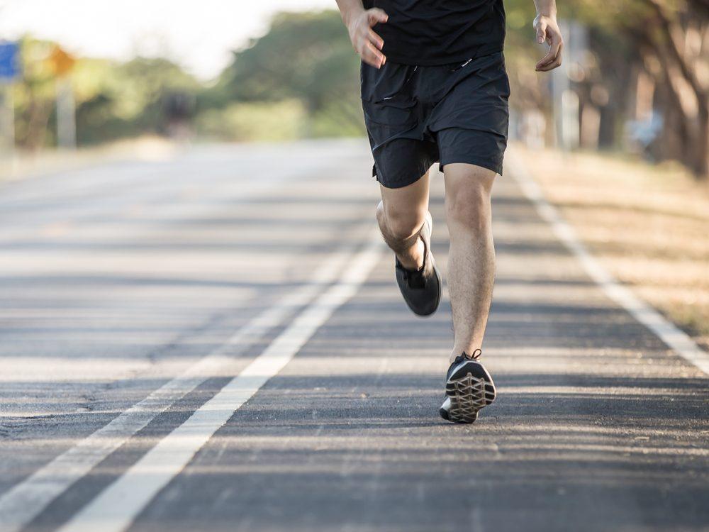 Medium shot of male jogger's legs while running
